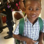 Happy recipient of shoes, backpack and school supplies to the Belle Glade and Pahokee Missions.